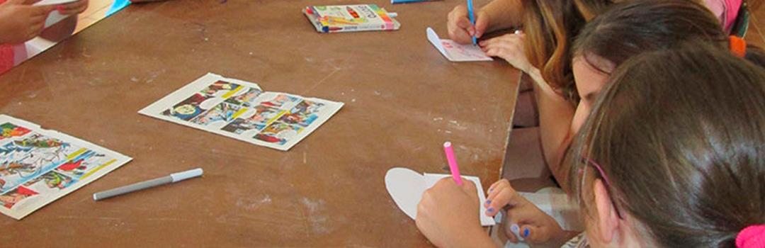 niños dibujando en proyecto social