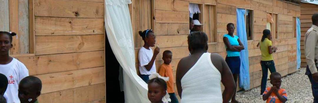 persona en hogares de proyecto social en Haití